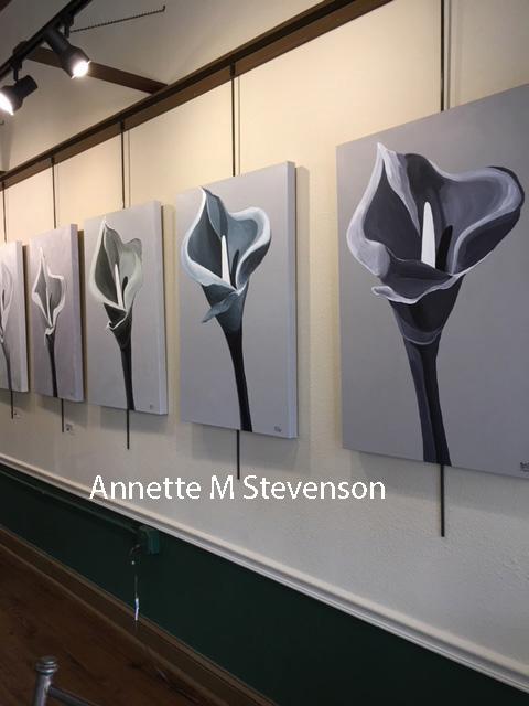 Series of quiet, peaceful elegant Solitude Paintings displayed in a gallery setting.